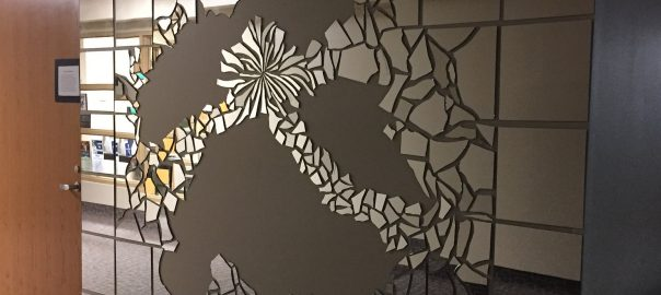 Mural made of shattered mirrored glass on display.