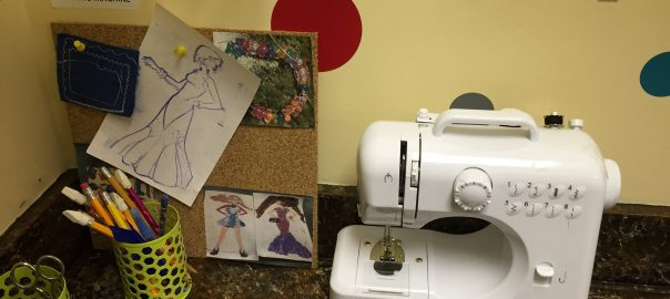 Sewing machine and inspiration board with prompt at the Zauel branch of the Saginaw Public Library.