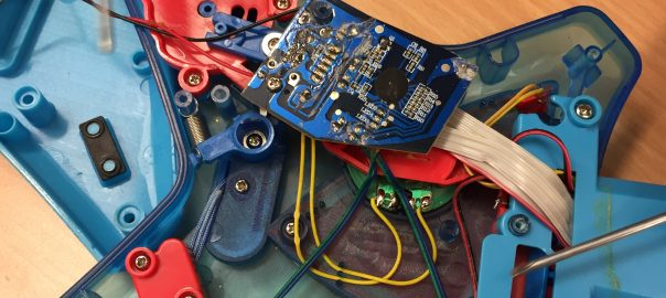 Decorative: Photo of inside of toy electronic guitar