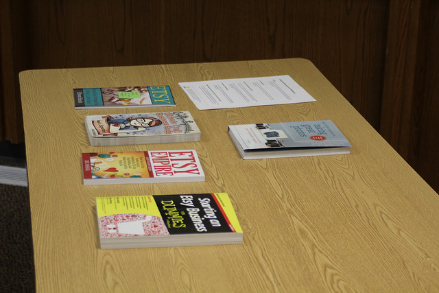 Books about Etsy on a table